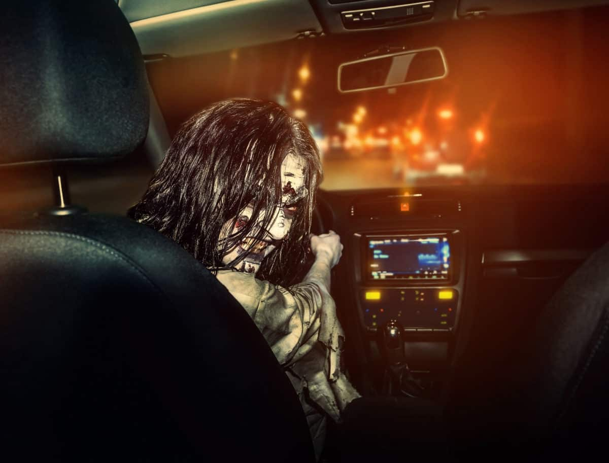 undead girl with bloody face rides in the car PZ872EN